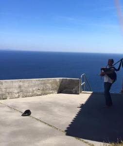 Bagpiper at the end of the earth. Photo by Ramona Young