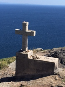 A stone cross at Fisterre where [pilgrims leave a rock they have carries on theor pilgrimage. It symbolizes shedding the weight of the burdens they carry.