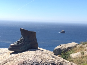 A metal scu;pture of a boot overlooks the ocean at Fisterre, symbolic of the end of the pilgrims' camino.